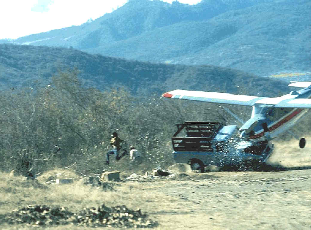 Due to strong crosswinds, a landing plane crashes with a truck standing near the runway, 1976