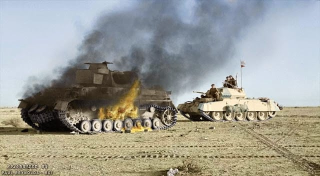 A British Crusader tank passes a burning German Panzer IV tank during 'Operation Crusader'. Cyrenaica (the eastern province of Libya). Winter 1941. (Colorized by Paul Reynolds. Historic Military Photo Colourisations)
